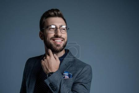 man in suit scratching beard