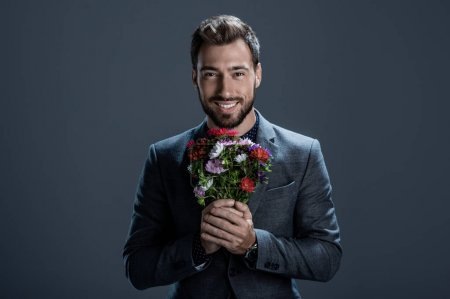 Handsome man holding bouquet