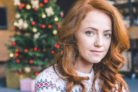 woman in warm sweater on christmas