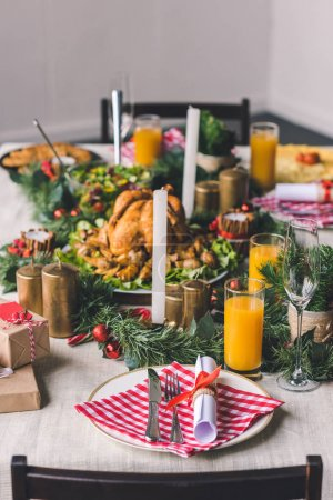 Photo for Beautiful christmas decorated table with delicious dishes - Royalty Free Image