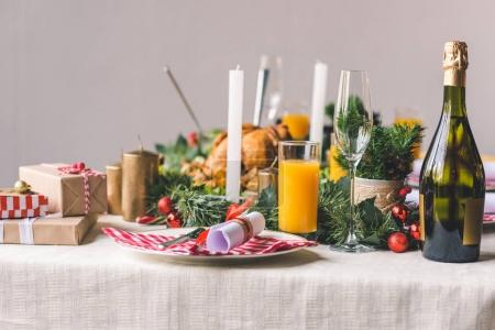 Photo for Christmas decorated table with tasty dishes - Royalty Free Image
