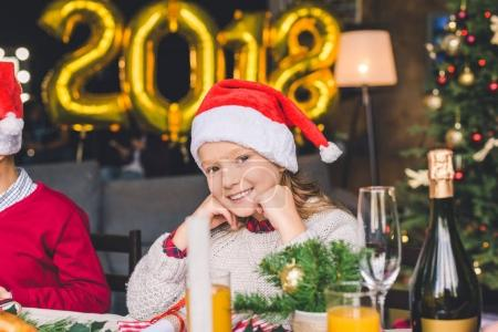 girl sitting at christmas table