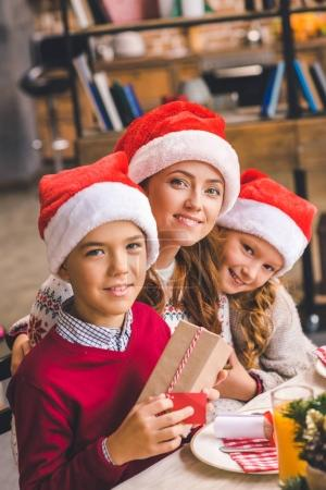 Mother and kids with christmas gift
