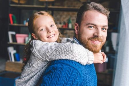 Photo for Happy daughter piggybacking on her handsome bearded father - Royalty Free Image