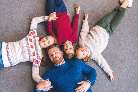 family laying on floor