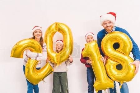 family holding new year balloons