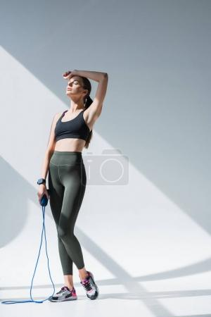 athletic girl with skipping rope