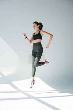 jumping girl in sportswear