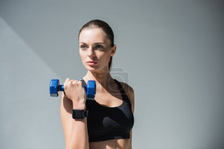 athletic girl with dumbbell