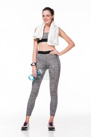 sportswoman with towel and bottle of water