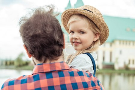 smiling child in straw hat