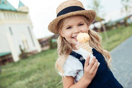 Smiling child with ice cream