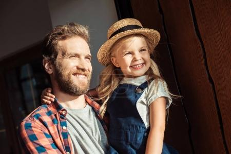 father holding daughter on hands