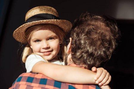 child in straw hat