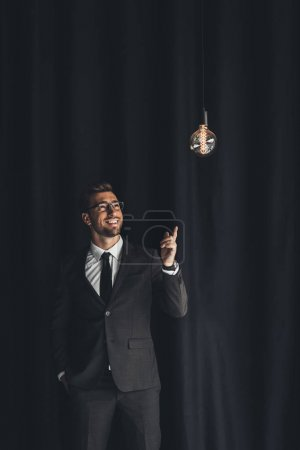 handsome businessman with lightbulb