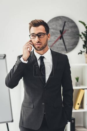 Businessman talking by phone