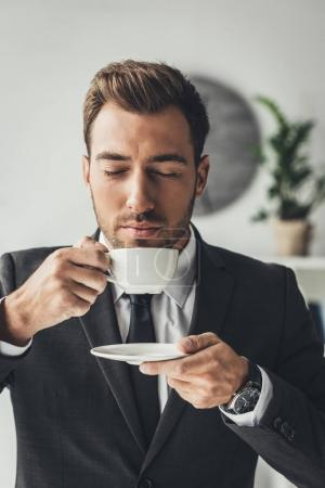 businessman enjoying aromatic coffee