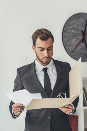 businessman with documents folder