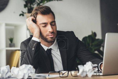 sleeping overworked businessman