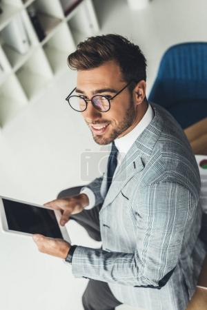 Photo for High angle view of young businessman using digital tablet - Royalty Free Image