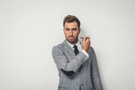 businessman drawing himself with pencil