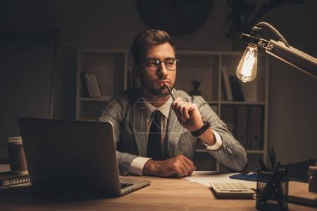 businessman in office at late evening