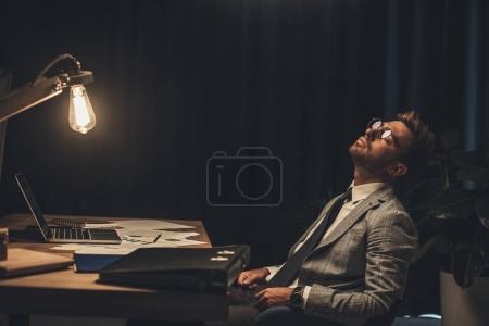 sleeping businessman in office