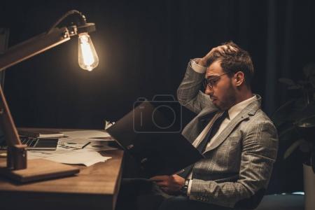 overworked businessman with paperwork