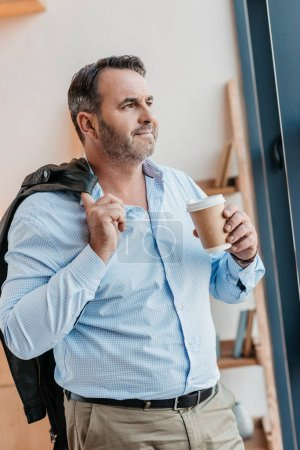 businessman with disposable cup of coffee