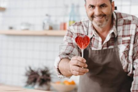 bartender with lollypop in shape of heart