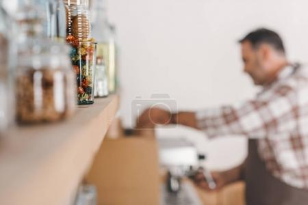 Shelf with bottles at cafe