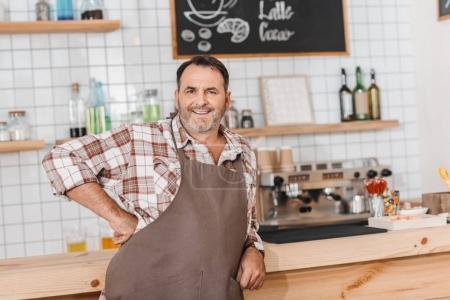 bartender leaning on bar counter