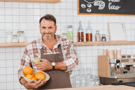 Bartender with bowl of fruits