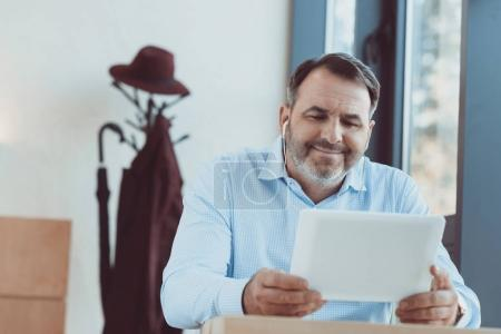 Man watching movie with tablet