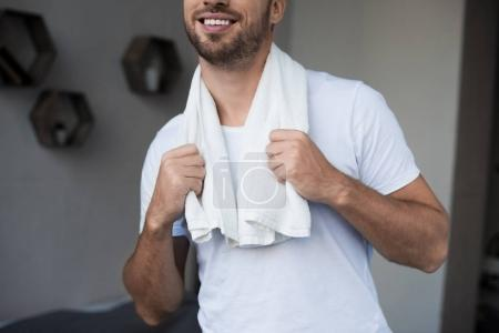 man with towel on shoulders