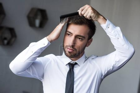 businessman combing hair