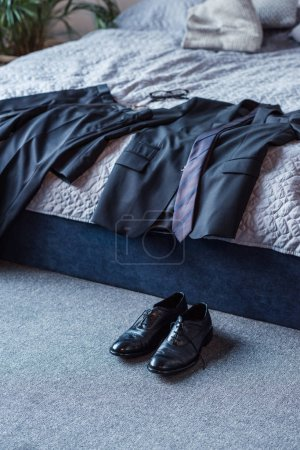Business suit on bed