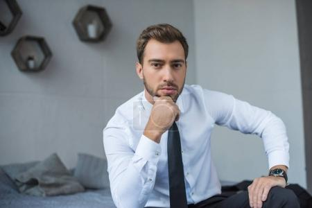 businessman sitting on bed