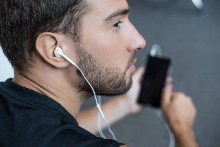 man wearing earbuds