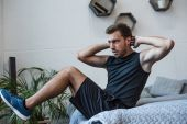 Man exercising on bed