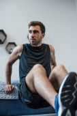man doing exercises in bedroom