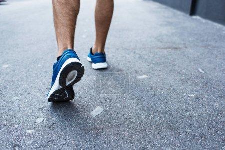 sportsman jogging outside