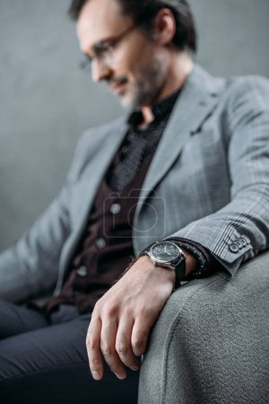 stylish businessman with wristwatch