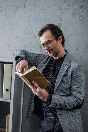 businessman reading book