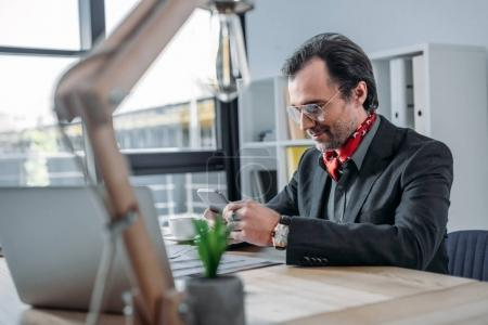 businessman using laptop and smartphone