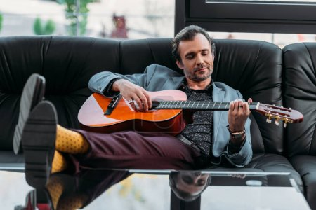 stylish man playing guitar