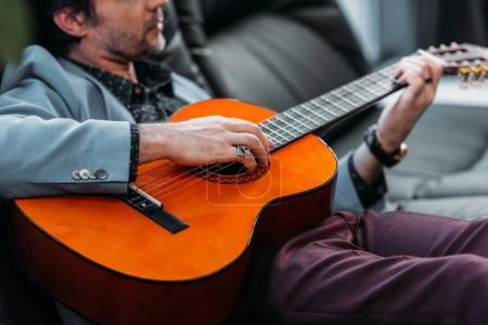stylish man playing guitar