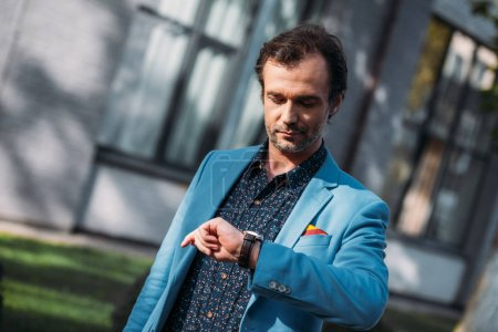 man checking wristwatch