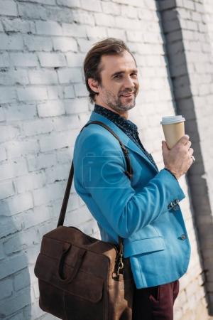 stylish man with coffee to go