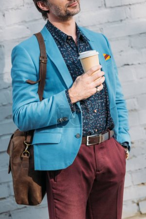 stylish man with coffee to go